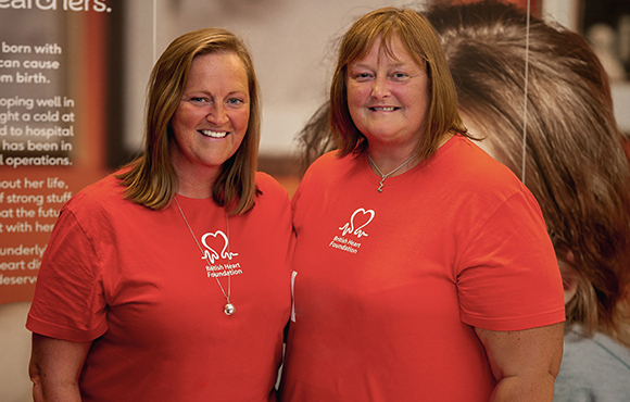 Two BHF colleagues smiling for the camera