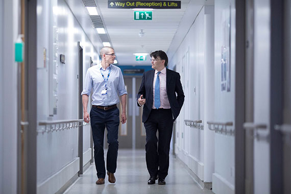 Two doctors walking down a corridor