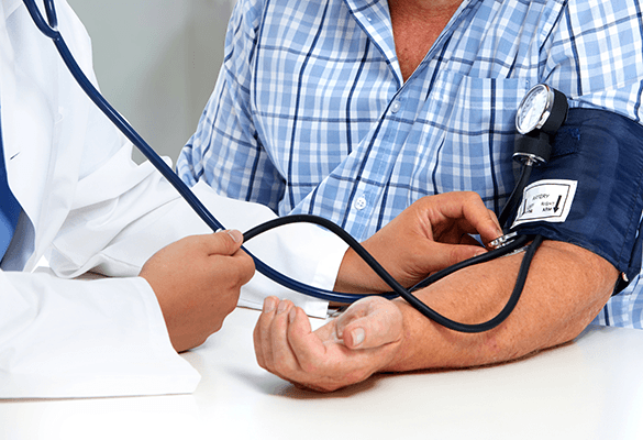 Man receiving a blood pressure test