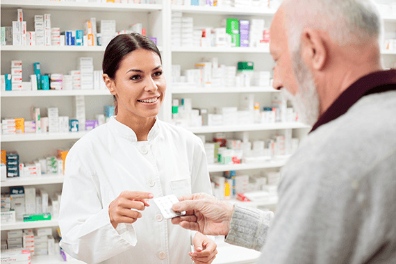 A pharmacist speaks with a patient