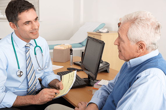 A GP speaking with a patient