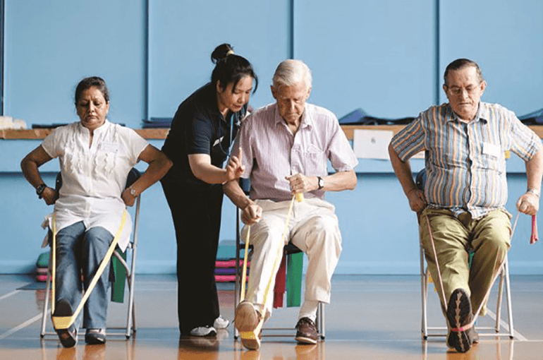 Seniors in an exercise hall