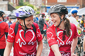 Two BHF employees laughinh at L2B bike ride