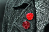 Two red pin badges