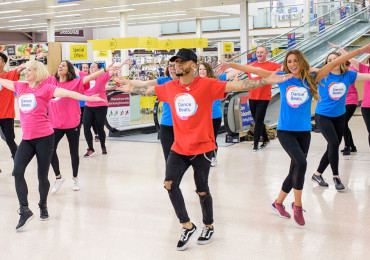 dancers doing a flash mob in Tesco