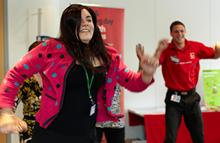 Employees doing exercise at a workplace wellbeing event