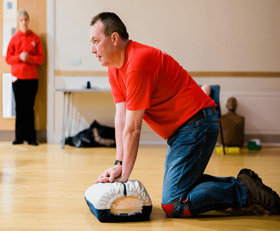 Heartstart instructor demonstrating CPR