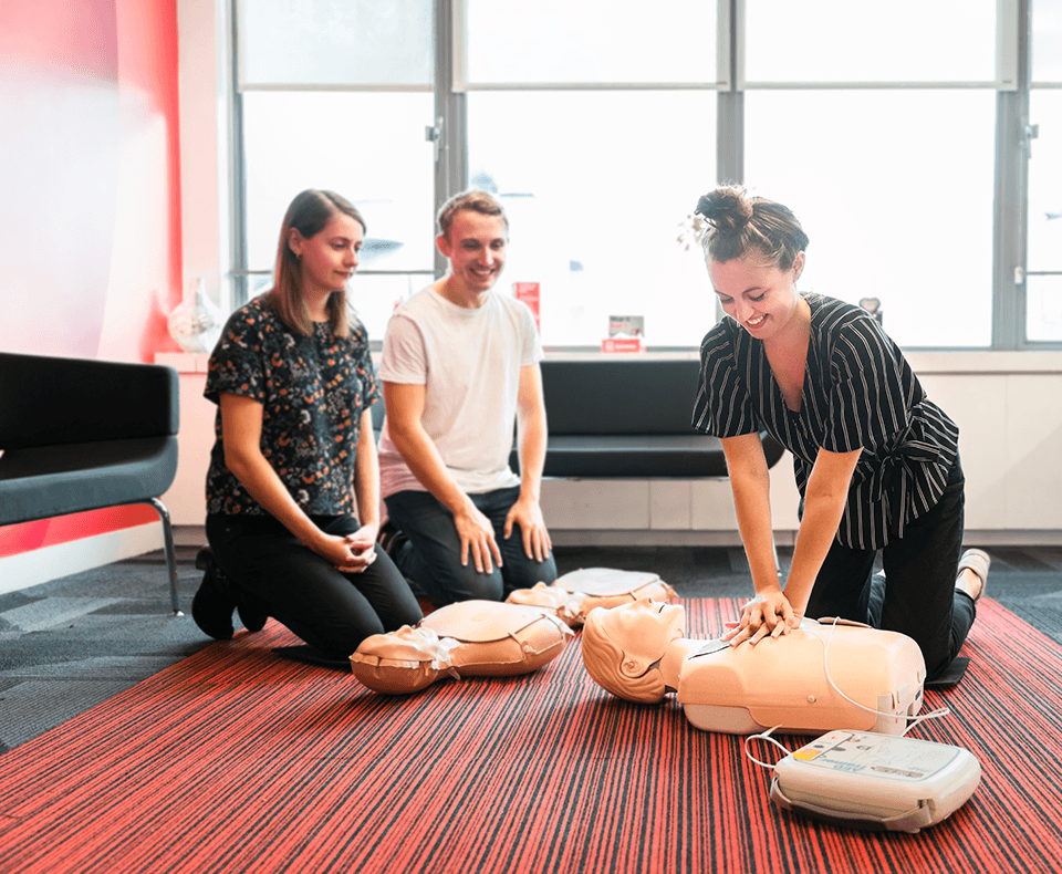 A group of colleagues learning CPR