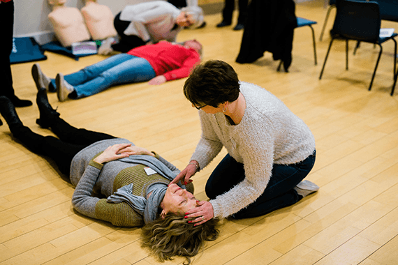 Two women learning CPR