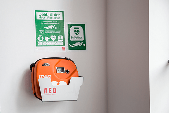 Defibrillator in a case on a wall