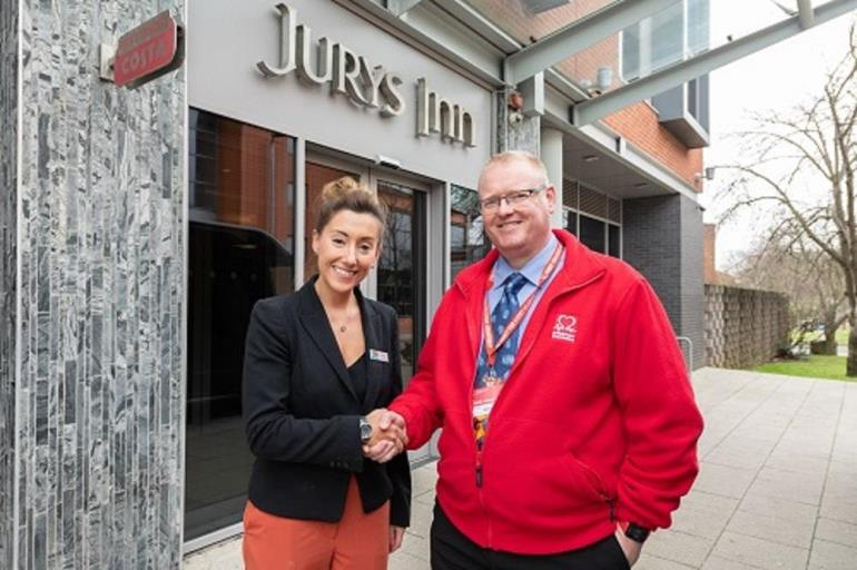 Jury's Inn Exeter manager with BHF employee.