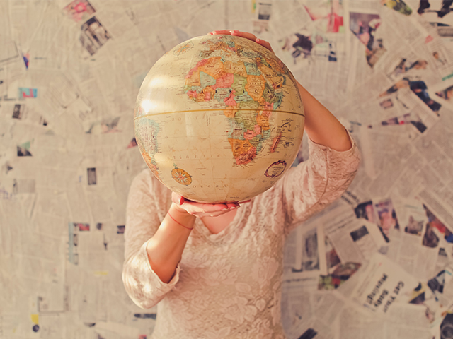 A person holding a globe for World Earth Day