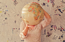 Person holding globe for World Earth Day