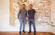 British designer, upcycler and TV presenter, Max McMurdo and his assistant Phillip Ely