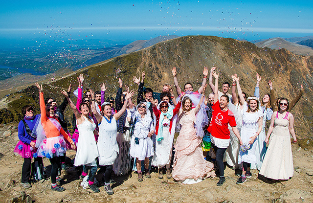 BHF fundraisers in wedding dresses at the top of Snowden