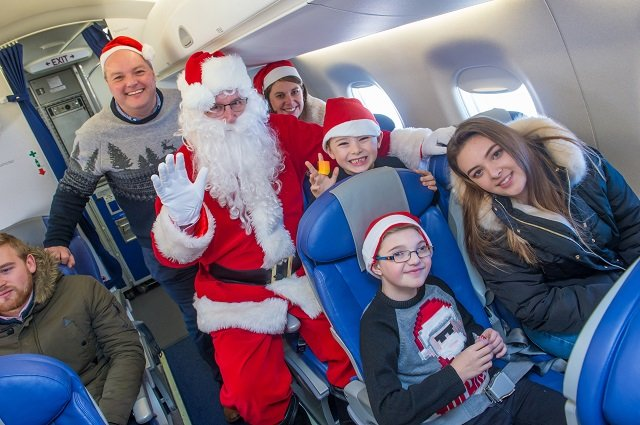 Morris family aboard Santa's flight with Santa Claus