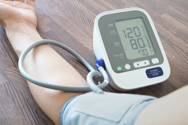 Image of blood pressure monitoring machine taking a reading