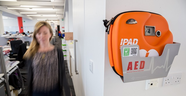 a defibrillator on a wall in an office