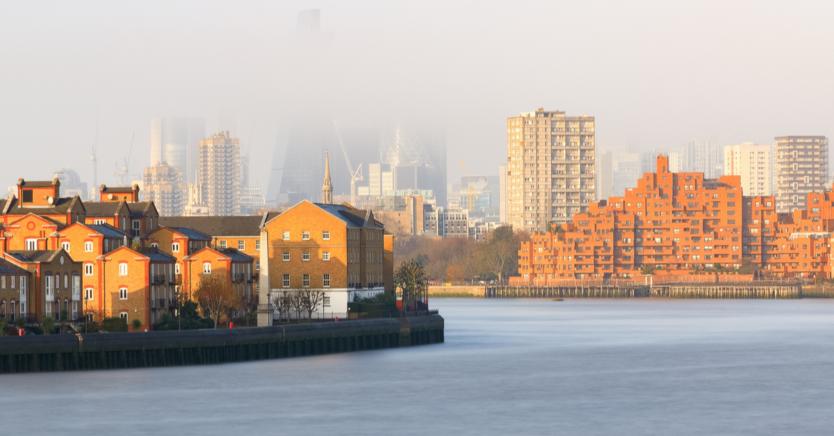 a picture showing the view down the river thames with a haze