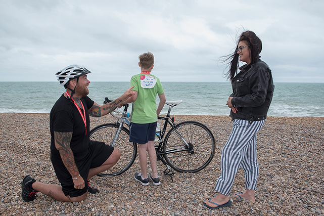 Doug proposes to Summer on the sea front at Brighton after completing the race. Doug's son Cameron has a sign on his back asking whether Summer will marry Doug.