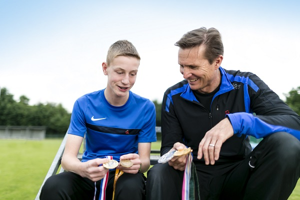 Luke Ball and Roger Black compare athletics medals
