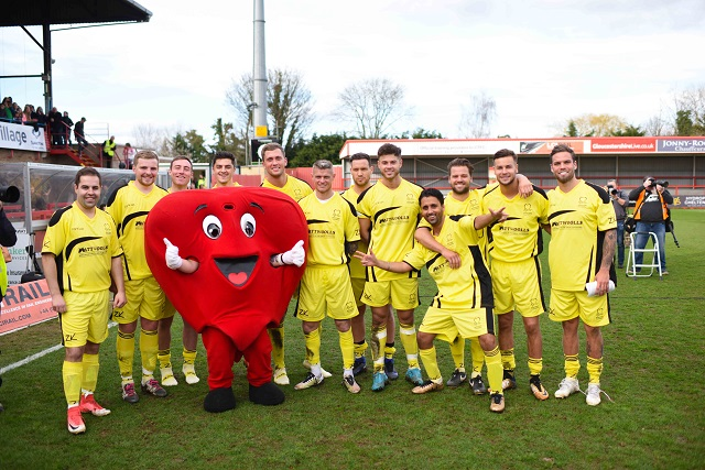 celebrity football team smiling with Mr Hearty