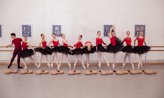 students at ballet school pose with CPR manikins