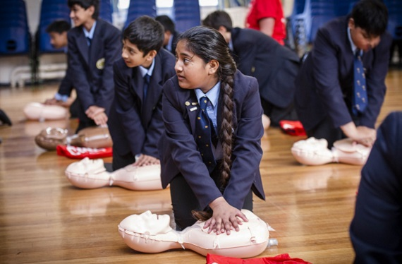 Students in a school practising CPR