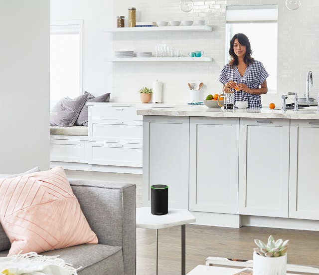 lady in kitchen with Amazon Echo on a table