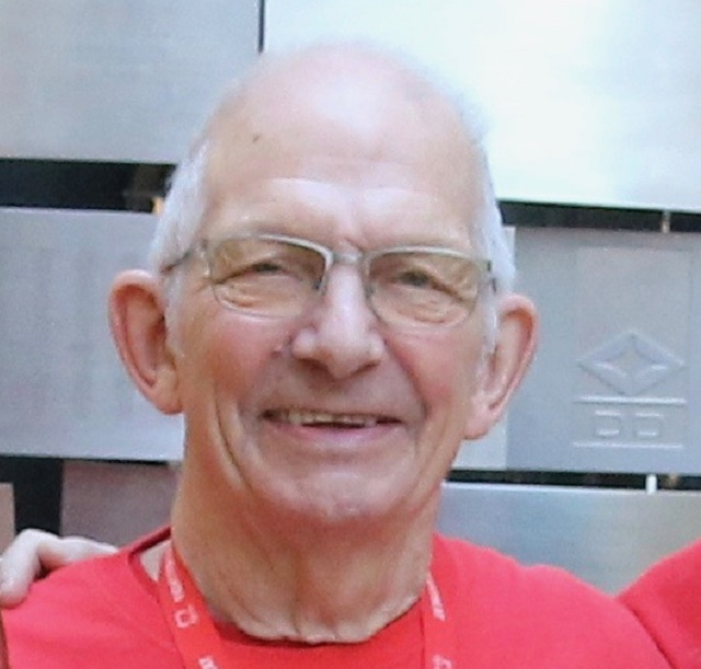 A portrait of Jim Waller, BHF case study, looking straight at the camera and wearing a red BHF T-shirt.